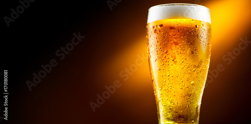 Poster Biere, Cidre Beer. Glass of cold beer with water drops. Craft beer isolated on black background
