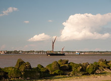 Moored Black And Red London Barge Vessel In Front On Moored And Docked Boats In Black Water Maldon Landscape
