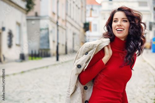 Fotografija  Beautiful woman in autumn style in town. Fashionable concept