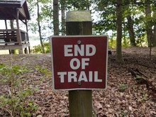 Brown And Red End Of Trail Sign
