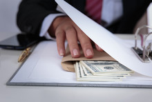 Businessman Receive Money In The Envelope Offered In File - Anti Bribery And Corruption Concepts