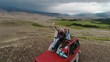 Couple On Road Trip Sit On Convertible Car Taking Selfie for drone 4k slow motion aerial shot.