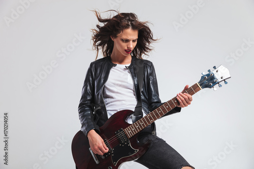 Fotografie, Obraz passionate woman guitarist with flying hair playing