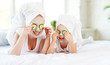 canvas print picture - Happy family mother and child daughter make face skin  mask.