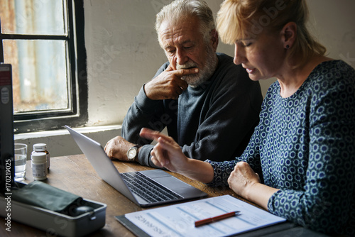 Fotografie, Obraz  Elderly couple planning on life insurance plan
