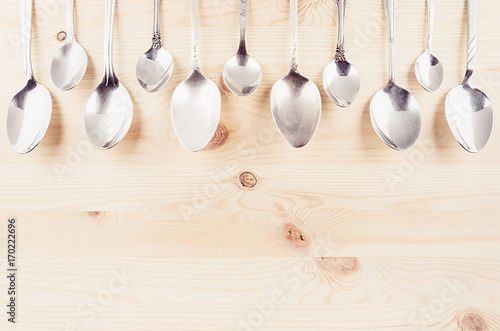 collection-rustic-empty-spoons-on-beige-wood-background-mock-up-for-designer-restaurant-menu-advertising