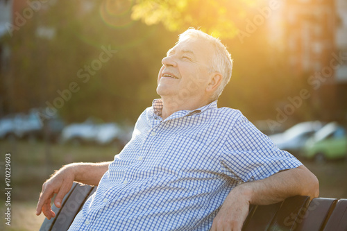 Fotografie, Obraz  Outdoor portrait of senior man who is enjoying sun.