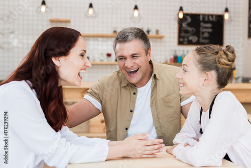 Fototapety, obrazy: beautiful family in cafe