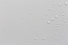 Water Droplets On A Gray Backg...