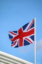 Union Jack Flag On Bright Blue...
