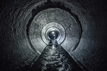 Diggers Are Exploring Underground River Flowing In Round Sewer Tunnel