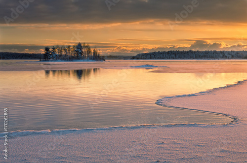 Poster Gris Winter landscape with river and island at sunset