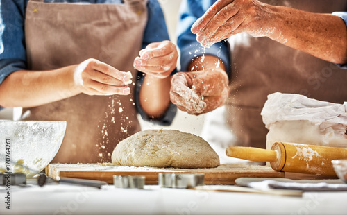 Hands preparing dough