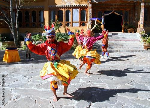 PARO, BHUTAN - November10, 2012 : Bhutanese dancers with colorful animal mask pe Wallpaper Mural