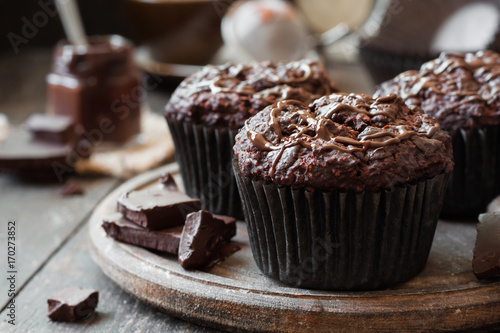 Fotografie, Obraz  chocolate muffins on a wooden background