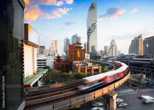Fototapeta  BTS skytrain and Mahanakhon building in background at business's district at sil