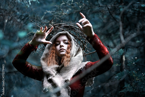 Fototapeta  Red-haired witch in a dense forest