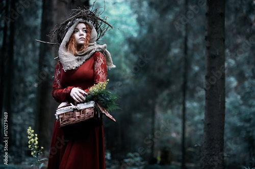 Fotografie, Obraz  Red-haired witch in a dense forest