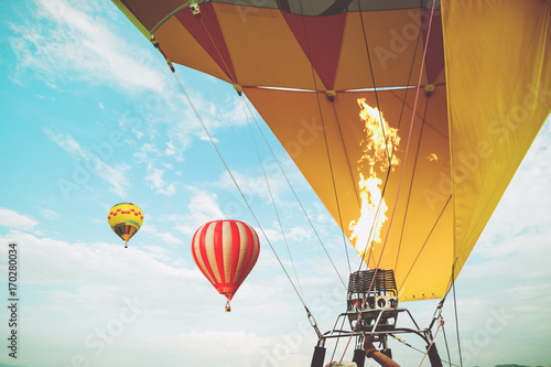 Close-up of hot air balloons with fire blue sky background applying retro and vintage filter effect styles. balloon carnival in Thailand