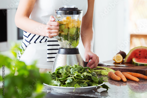Vegetarian preparing vegan smoothie