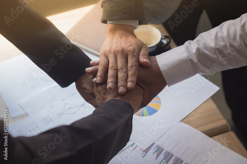 Fototapety, obrazy: Business people coordinate hands in office. Concept Teamwork.