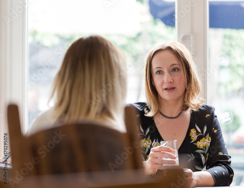 Fotografie, Obraz  Young adult woman listen to opponent at informal business meeting