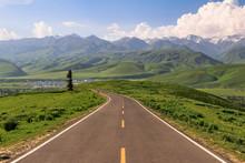 Road Through Grasslands And Mo...