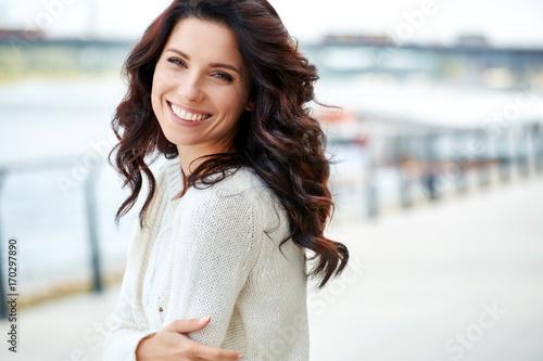 Fotografie, Obraz  lovely beautiful woman in a woolen sweater. Beauty concept