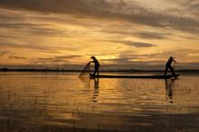 Silhouette Two Fishermen Worki...