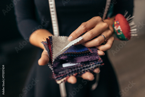 Female hands with fabric swatch