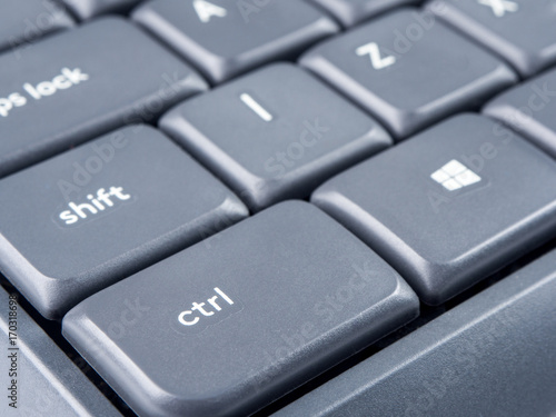Photo  Gray keyboard with focus on Strl and Shift buttons and soft focus on back