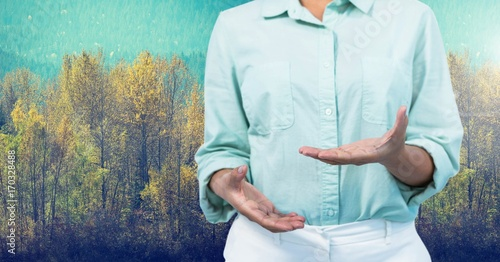 Valokuva  Businesswoman in nature forest explaining with hands
