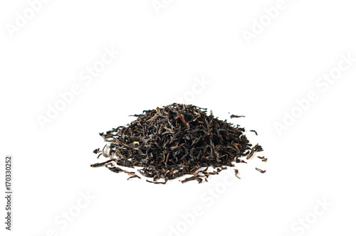 Dry black tea isolated on white
