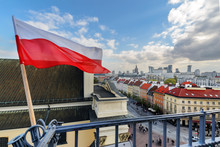 Poland Flag In Blue Sky And Wa...