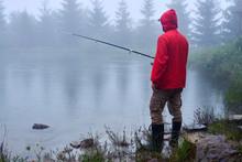 Man In Waterproof Jacket Fishi...