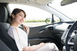 young woman sitting on assistant seat of motor vehicle.