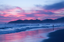 Cloudy Blue & Pink Sunset Over...