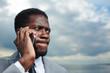 Tense businessman speaking by smartphone outdoors