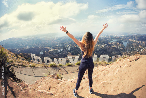 Young woman at the top of Hollywood, Los Angeles, California Wallpaper Mural