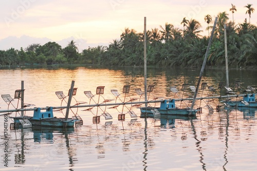 Valokuva shrimp farm with paddle wheel aerator