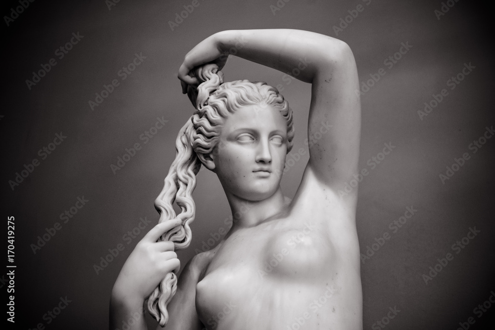 Photo  White marble young woman isolated on black background