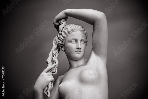 Foto auf Leinwand Historische denkmal White marble young woman isolated on black background. Venus (Aphrodite) goddess of love for interior posters, prints, wallpapers, design, cover. Historic heritage, sample of female beauty, classicism