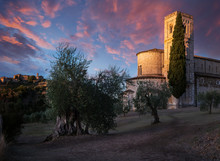 Stunning Sunrise Between Village And Abbey - Sant'Antimo Abbey, Castelnuovo Dell Abate, Montalcino, Tuscany, Italy, Europe.