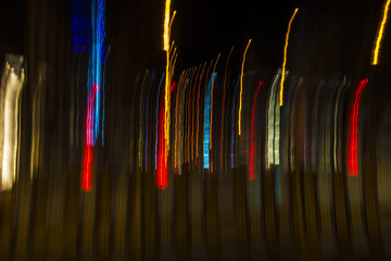 Colored lights in motion at night as abstract background