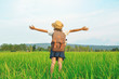 Happy girl backpack in green field , Relax time on holiday concept travel