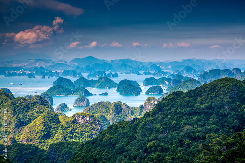 Poster Bleu nuit scenic view over Ha Long bay from Cat Ba island, Ha Long city in the background, UNESCO world heritage site, Vietnam