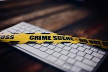 Yellow Crime Scene Tape On Com...