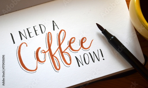 Photo I NEED A COFFEE NOW hand lettered in notebook