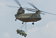 Chinook Helicopter Carrying A Jeep