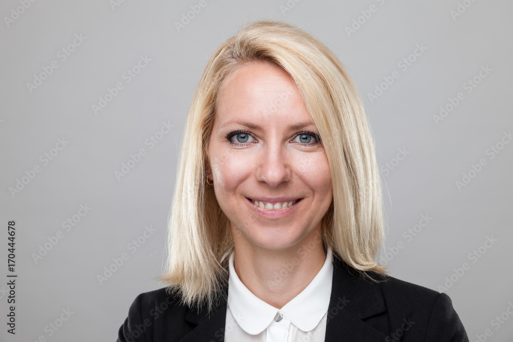 Fototapeta Headshot of young and happy business woman